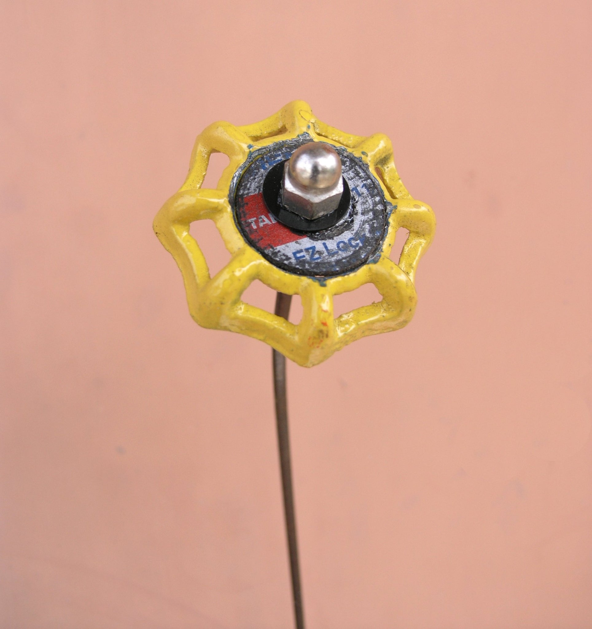yellow faucet spigot handle flower