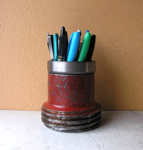 red metal pencil holder for desk