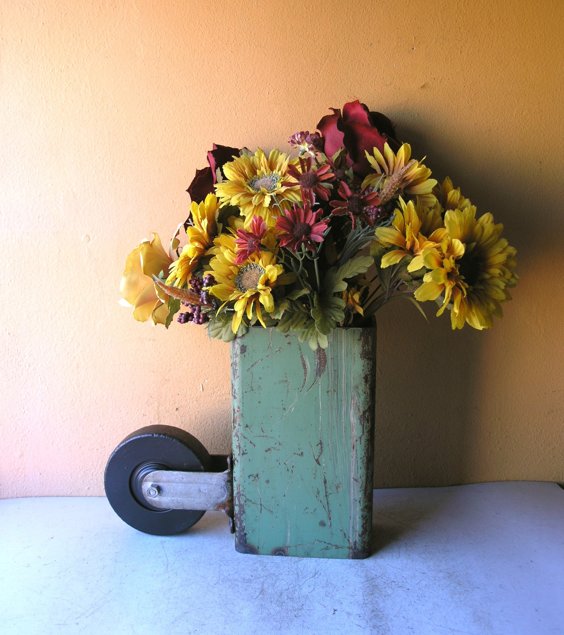 industrial flower vase with caster wheel