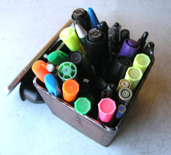 industrial metal pencil holder holds lots of pens