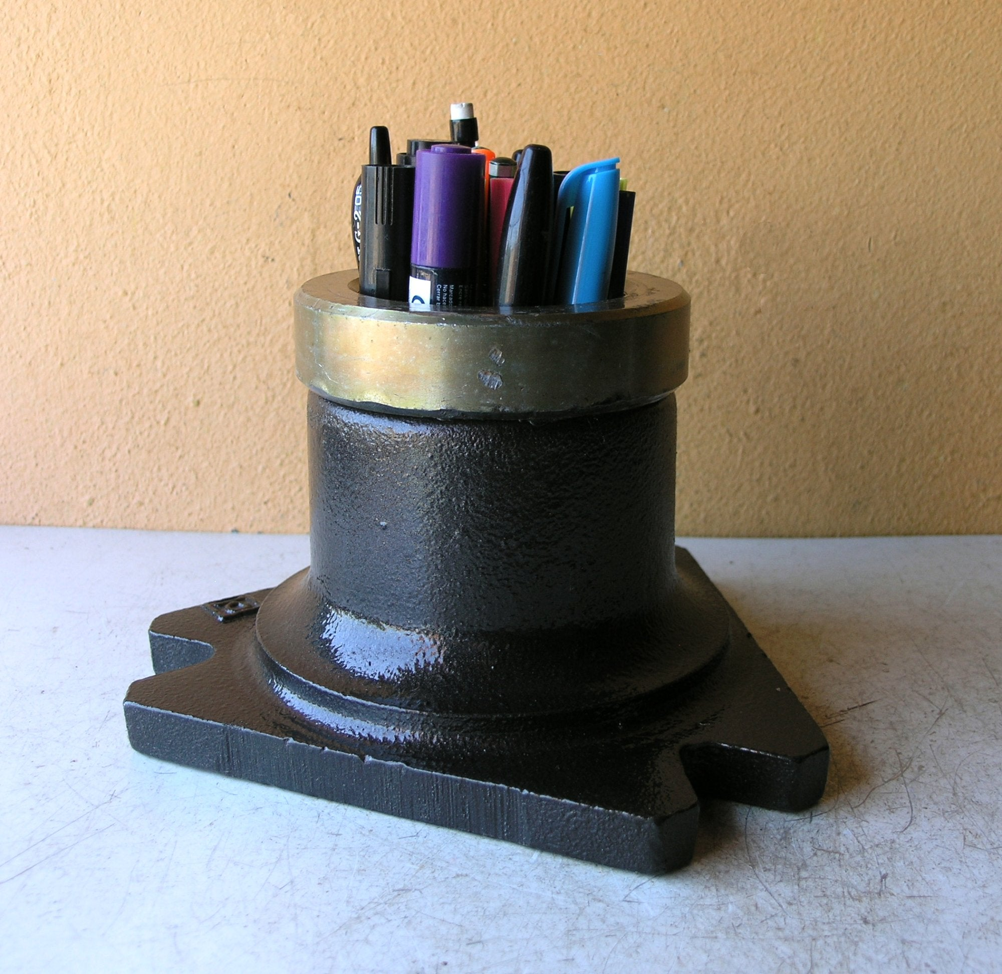 salvaged post base anchor, recycled into a pencil holder