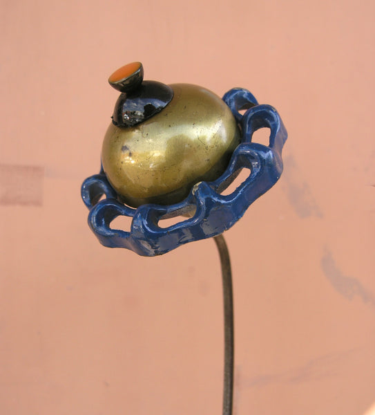 brass metal and button flower