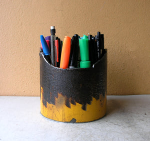 yellow metal pencil cup