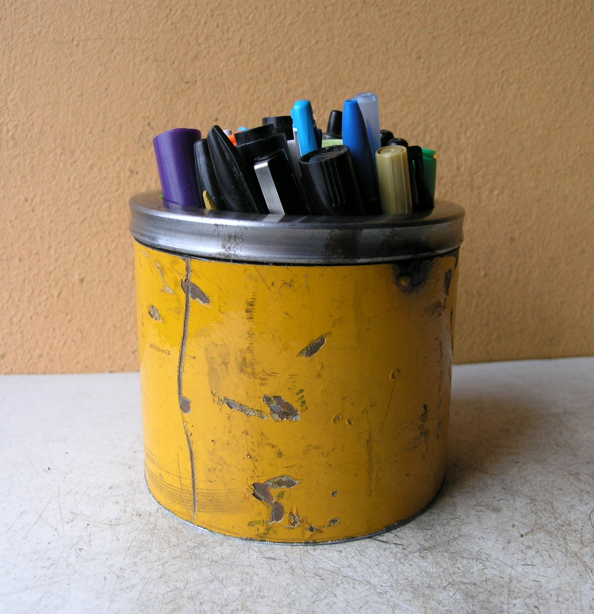 large yellow metal pen holder