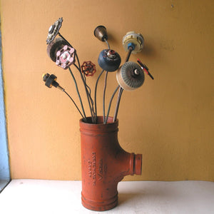 Upcycled tall metal flower vase from scrap metal pipe