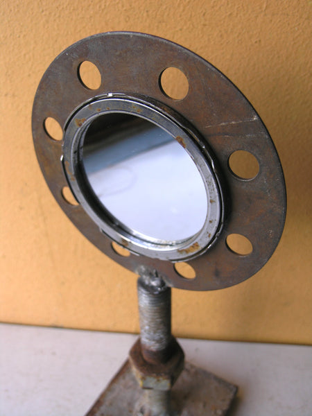 close up of double sided metal mirror