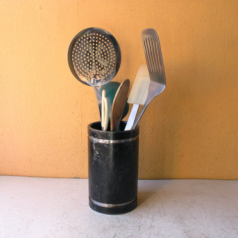 black metal utensil holder for kitchen