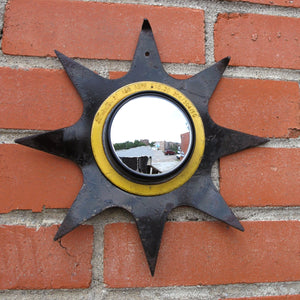 sunburst wall mirror made from upcycled tiller blade