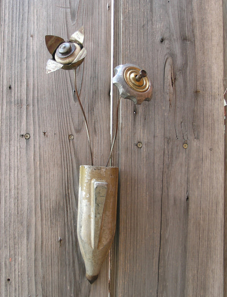 gray and silver pocket vase with upcycled flowers
