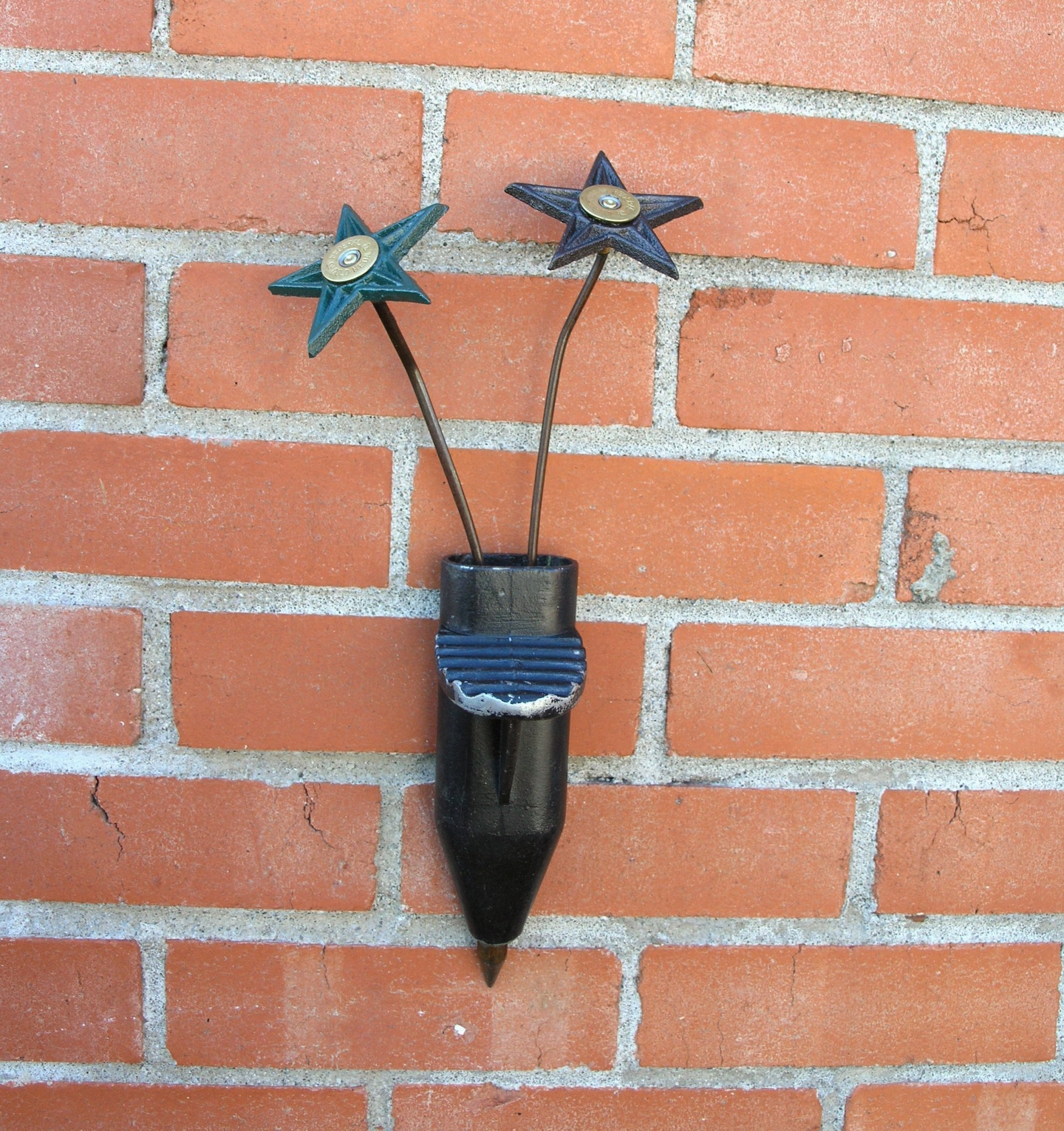 hanging wall vase with cast iron star flowers