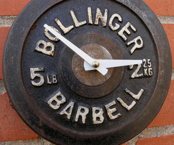 close up of bollinger 5 lb barbell wall clock