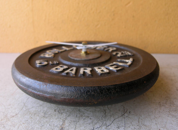 side view of barbell wall clock
