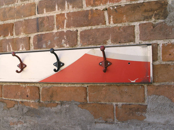 close up of red white blue coat rack