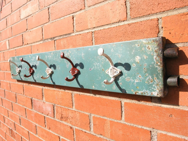 side view of aqua coat rack on wall