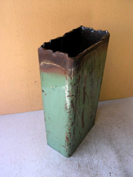 side view of green metal vase