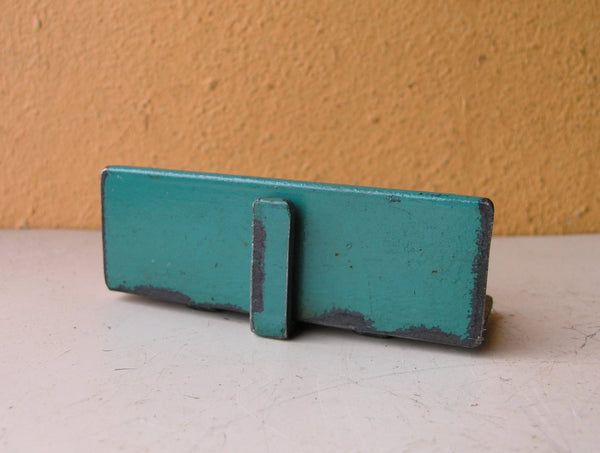 back view of blue green angle iron card holder