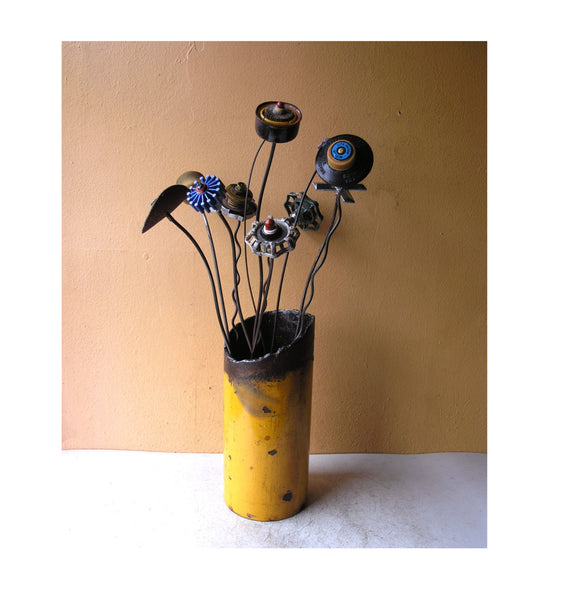 upcycled flowers in salvaged steel pipe vase