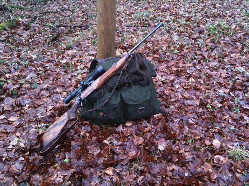 Backpack with a hunting rifle