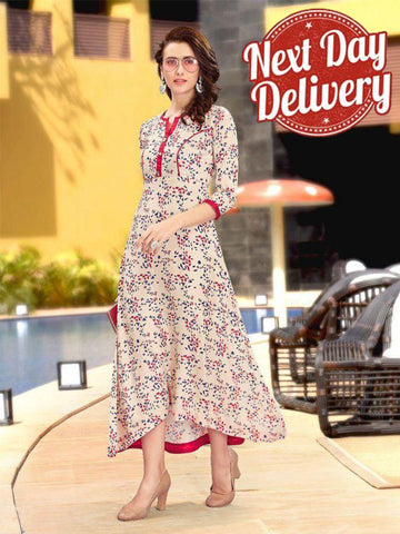 A Beautiful Printed Beige Color Rayon Kurtis