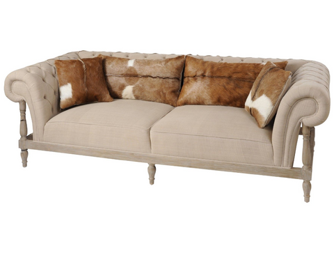 Three Seater stone coloured cotton sofa With Goat Skin Cushions