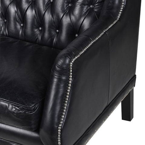 Black Buttoned Sofa with studded detail