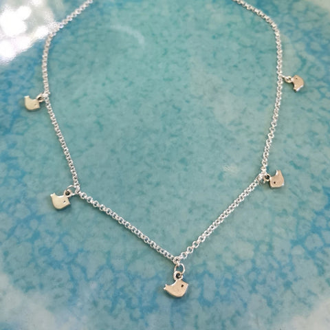 Silver tone little birdie multiple charm necklace