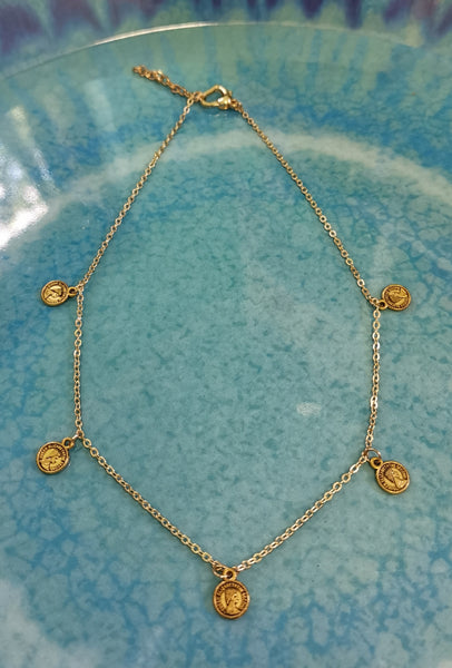 Gold tone peso coin multiple charm necklace