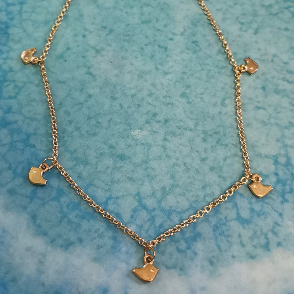 Gold tone little birdie multiple charm necklace