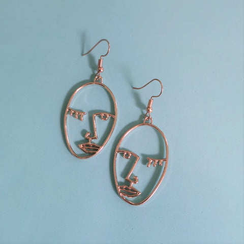 Gold face outline earrings - medium