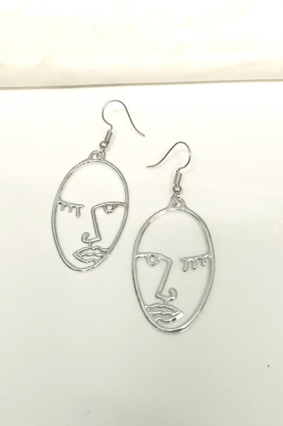 Silver face outline earrings - medium