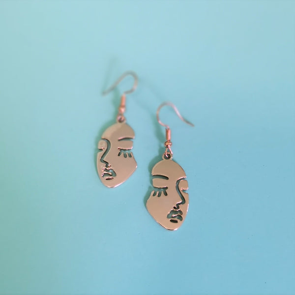 Gold face earrings - small
