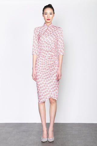 LOCAL NYLON BAG PATTERN PRINT QUARTER SLEEVES DRESS WITH RUFFLE AT WAIST AND ASYMMETRIC HEM