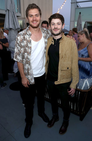 Actors Finn Jones (L) and Iwan Rheon attend the Entertainment Weekly and Marvel After Dark event at the EW Studio during Comic-Con at Hard Rock Hotel San Diego