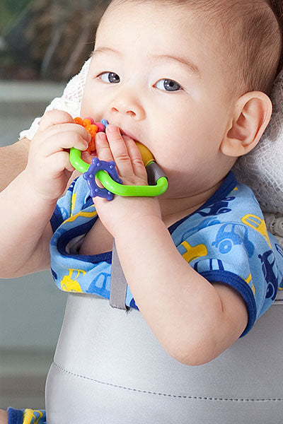 LapBaby hands-free seating aid has an attachment strap for toy, soother or rattle.