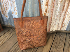 Fully leather lined hand tooled hand tooled, leather tote/purse
