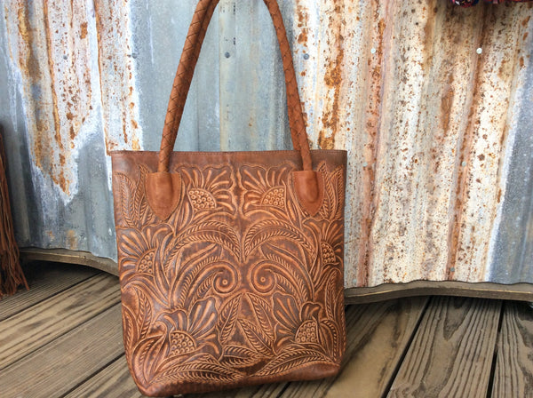 Fully leather lined hand tooled hand tooled, leather tote/purse.