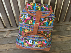 Large, hand woven huipil backpack finished in high quality nubuck leather.made with a huipil from San Antonio Aguas Calientes.