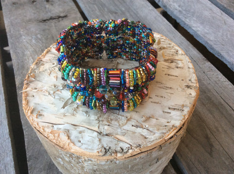 Magnetic clasp cuff style, hand beaded bracelet with crystals. Hand strung in Santiago Atitlan Guatemala. Two beautiful color combinations.
