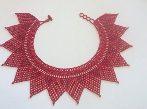 Red collar style beaded necklace.