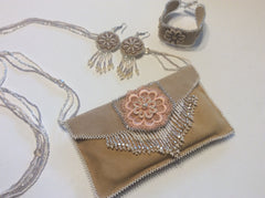 Soft leather, hand beaded accents evening bag with matching bracelet and earrings