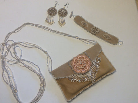 Soft leather, hand beaded accents evening bag with matching bracelet and earrings. Phone purse.
