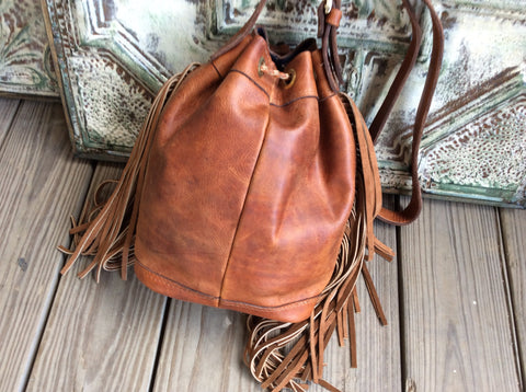 Top grain,oil rubbed leather and handwoven fabric barrel bag