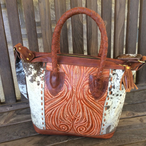 Show stopper, hand made cowhide, leather mini tote!