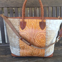 Handmade, hair on hide, hand tooled leather travel bag