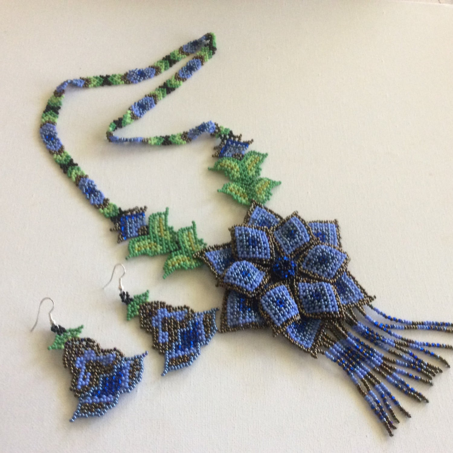 classic huichol hand beaded necklace blue and bronze colored seed
