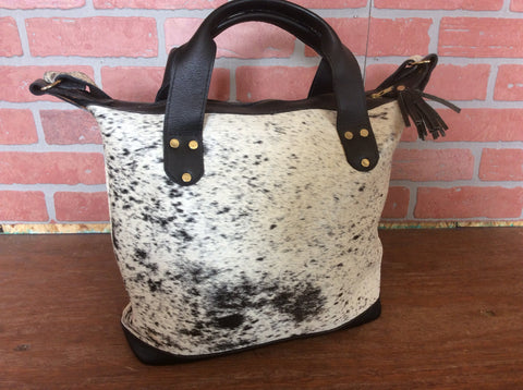 Black and white hide handmade cowhide leather tote bag/ purse.