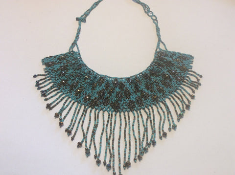 Beautiful bronze and turquoise hand beaded necklace. Statement piece.