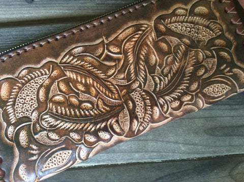 Hand tooled, leather western style wristlet. Beautiful hand laced, full grain leather wristlet.  Brown rodeo wristlet.