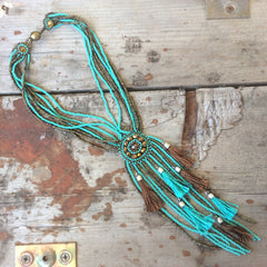 Turquoise and bronze glass seed bead necklace with hand made silk tassels.