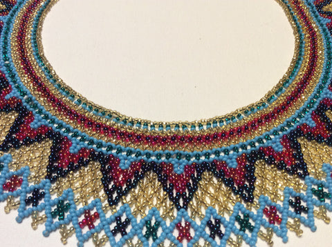 Beautiful hand beaded collar necklace. This necklace resembles a beaded collar.